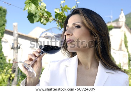 Adult woman tasting wine - stock photo