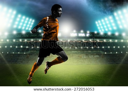 Adults. One brazilian soccer football player young man heading in silhouette studio isolated on white background - stock photo