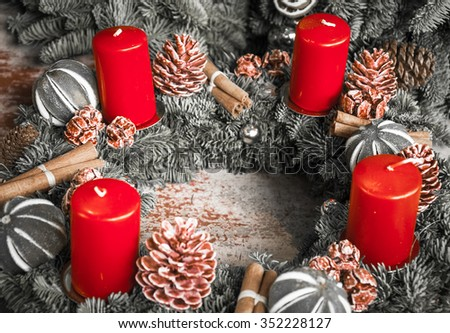 Advent wreath with red candles. Selective focus on remote candles. Toned photo. - stock photo