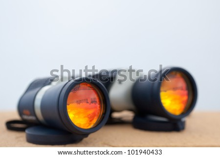 Adventure binoculars with copy-space - stock photo