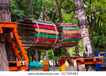 Adventure climbing high wire park, rope extreme park - stock photo