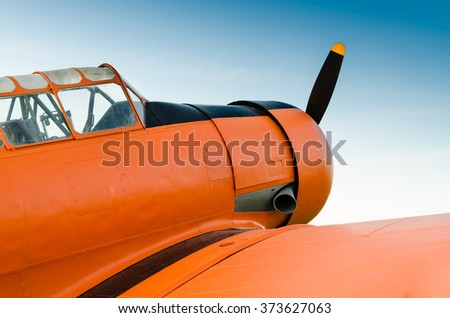 Adventure in the sky, Old airplane, orange - stock photo