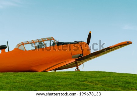 Adventure in the sky, Old airplane, orange, North American T-6G Texan - stock photo