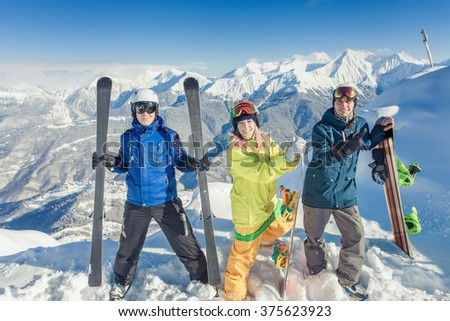 Adventure! Inspired group of snowboarders at summit. Winter sports. Switzerland, alps. Snowboard. Healthy lifestyle and outdoor activity - stock photo