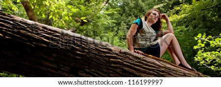 Adventurer Resting on a Log - stock photo