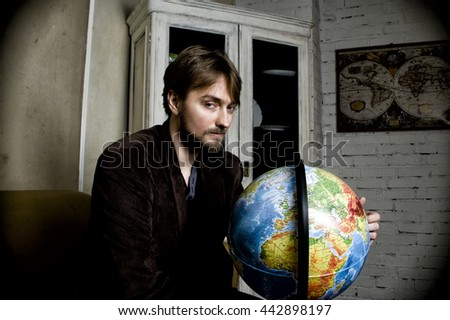 Adventurer with  globe. - stock photo