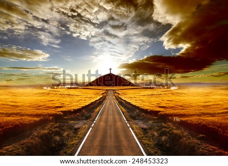 Adventures and road trips.Sunset and travel concept.Road and cross on the hill - stock photo