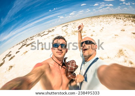 Adventurous best  friends taking selfie at Etosha national park in Namibia - Adventure travel lifestyle enjoying moment and sharing happiness - Trip together around the world as alternative lifestyle - stock photo