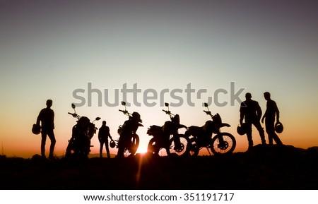 adventurous motorcyclists - stock photo