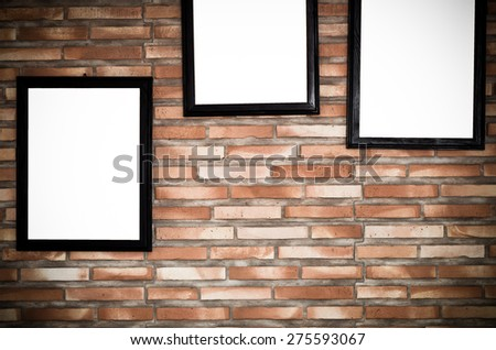 advertise frame on brick wall background - stock photo