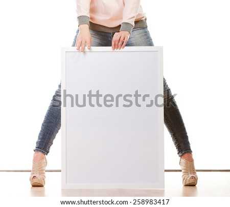 Advertisement concept. woman legs with blank presentation board. Female model showing banner sign billboard copy space for text. Isolated - stock photo