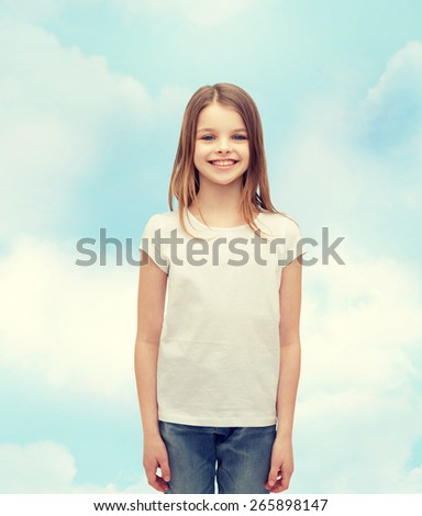 advertising and t-shirt design concept - smiling little girl in white blank t-shirt over white background - stock photo