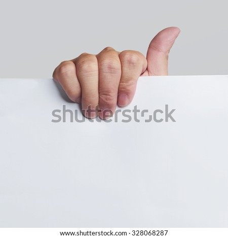 Advertising: Hand holding white empty paper . with clipping path - stock photo