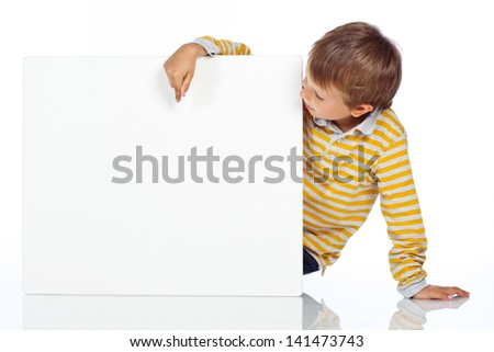 Advertising place for you, empty card, cute kid holding it - stock photo