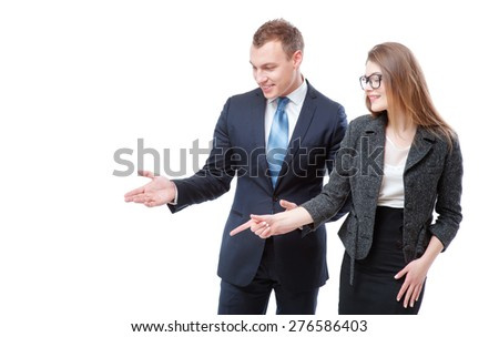 Advertising your product. Happy young couple businessman and businesswoman pointing copy space and smiling while standing isolated on white. - stock photo