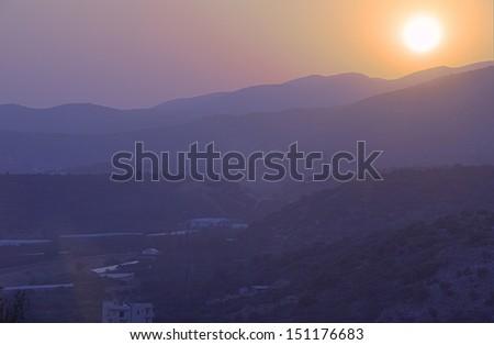 Aegean Sunrise - Sunrise over the Cretan mountains in Malia, Crete - stock photo