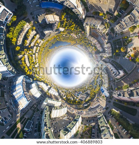 Aerial city view with crossroads, roads, houses, buildings, parks and parking lots, bridges. Copter shot. Reversed little planet mode. - stock photo
