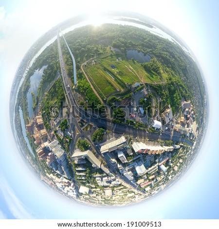 Aerial city view with crossroads, roads, houses, buildings, parks, parking lots, bridges - little planet spherical mode  - stock photo