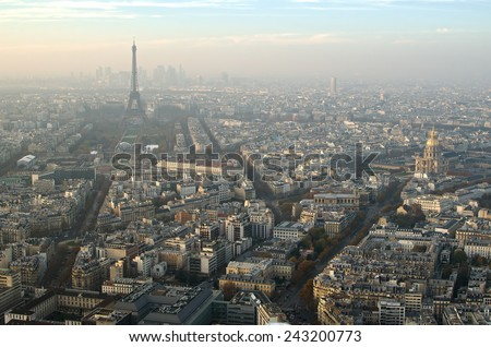 Aerial cityscape of Paris (France) in the fog. Famous beautiful Eiffel Tower (tour Eiffel) in the background.  - stock photo