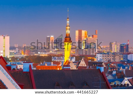Aerial cityscape with old town hall spire and modern office buildings skyscrapers in the background in the evening, Tallinn, Estonia - stock photo