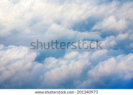 Aerial cloudscape from the airplane board - stock photo
