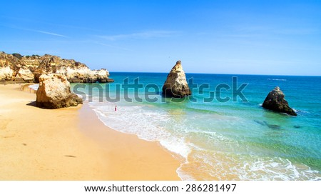 Aerial from natural rocks at Praia Tres Irmaos near Alvor in Portugal - stock photo