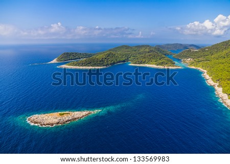 Aerial helicopter shoot of National park on island Mljet, Dubrovnik archipelago, Croatia. The oldest pine forest in Europe preserved. - stock photo