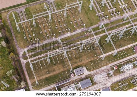Aerial image of electrical substation featuring wires, transformers and large scale power energy towers. - stock photo