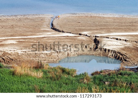 Aerial landscape view of a large sinkhole in The Dead Sea valley Israel. - stock photo