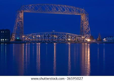 aerial lift bridge in Duluth on Lake superior at dusk - stock photo