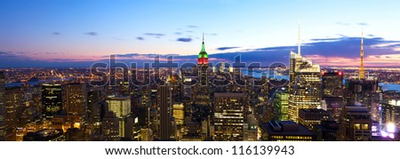 Aerial New York City skyline panorama at dusk with Empire State Building - stock photo