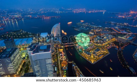 Aerial night view of Yokohama city skyline and ferris wheel of Cosmo world at dusk in Yokohama bay, Kanagawa Prefecture, Kanto region, Japan - stock photo