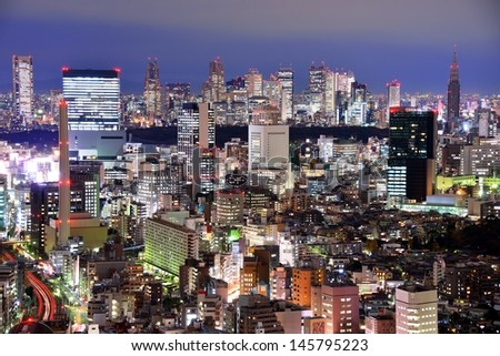Aerial night view over Ebisu, Tokyo, Japan looking towards the skyscraper district of Shinjuku. - stock photo