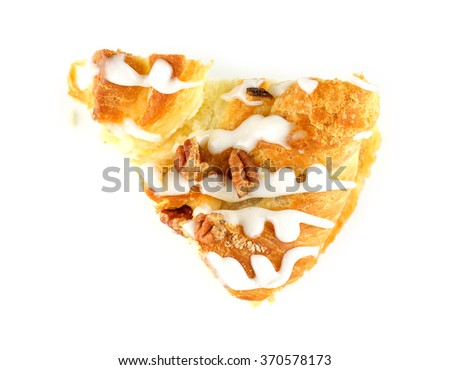 Aerial of baked custard and pecan danish dessert slice isolated on white - stock photo