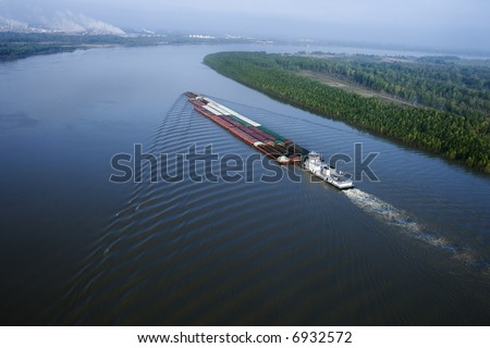 Aerial of barge on Mississippi River in Baton Rouge, Louisiana. - stock photo