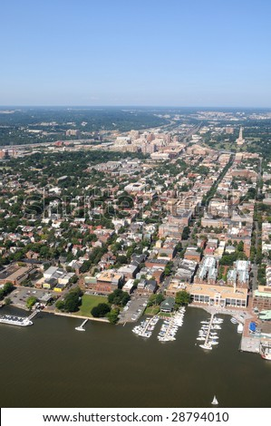 Aerial of downtown Alexandria, Virginia, on the Potomac River, near Washington DC, with a view of King Street leading from Waterfront Park to George Washington Masonic Memorial - stock photo