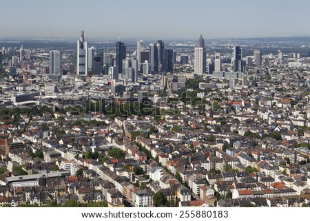 aerial of Frankfurt skyline on a sunny day with skyscrapers at horizon - stock photo