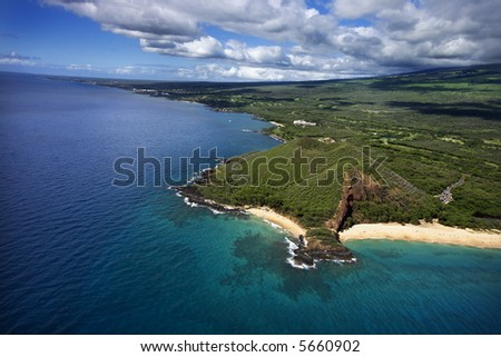 Aerial of Maui, Hawaii coastline with crater and cliffs and beach on Pacific ocean. - stock photo