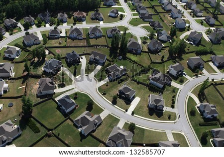 Aerial of modern suburban housing in the eastern United States. - stock photo