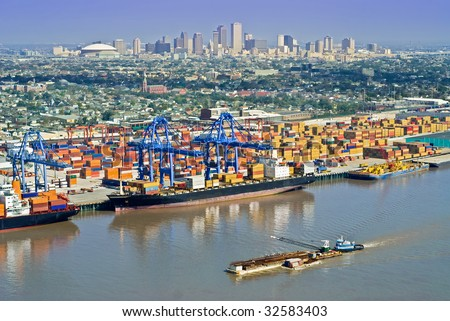 Aerial of New Orleans port activity with cityscape - stock photo