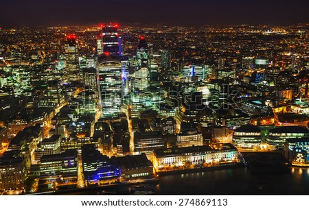Aerial overview of the City of London financial district at night - stock photo