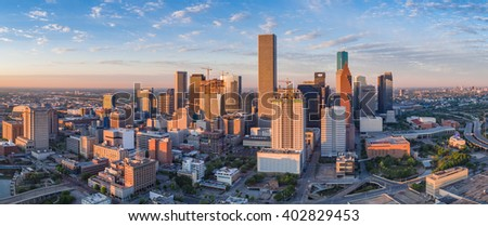 Aerial panorama of downtown Houston skyline as seen from the northeast side of town.  New building construction can be seen in the early morning light photo. - stock photo