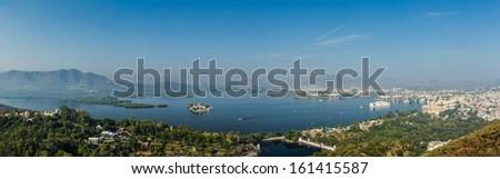 Aerial panorama of Lake Pichola and Udaipur with City palace, Lake Palace (Jag Niwas) and Jag Mandir (Lake Garden Palace).  Udaipur, Rajasthan, India - stock photo