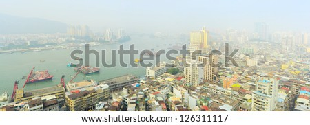 Aerial panorama of Macau in the sunshine morning - stock photo