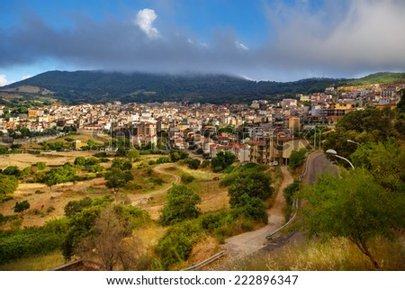 Aerial panorama view of the village Orgosolo, Province of Nuoro, Sardinia, Italy - stock photo