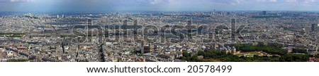 Aerial panoramic view from Montparnasse tower over north Paris, Seine river, Louvre, Notre Dame, Luxembourg gardens. Clouds are projecting shadows on the city. - stock photo
