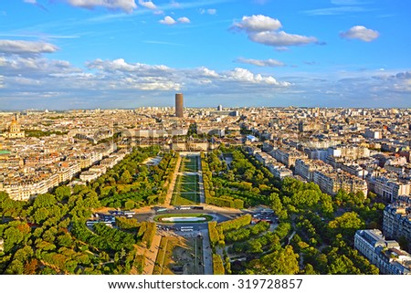 Aerial panoramic view of Paris and Champ de Mars from Eiffel Tower in Paris at sunset, France. - stock photo