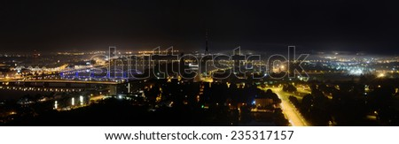Aerial panoramic view of Riga by night - stock photo
