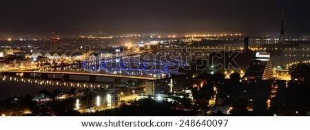 Aerial panoramic view of Riga by night - stock photo