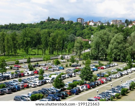 Aerial parking lot outdoors vehicles green park. - stock photo